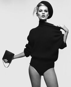 the great Kate moss in black body suit and sweater shot in black and white More