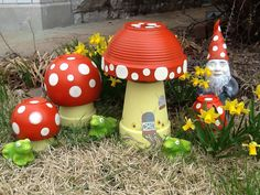 Dotty Mushroom Patch – Mary Engelbreit Studios. Made from clay flower pots and bowls. Cute!