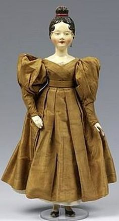 Doll in fashionable dress, ca. 1830 (made). Williamsburg Museum Number T.206-1957.