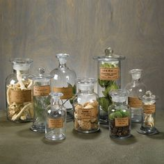 these are a must!  Vintage Apothecary jars.. I pit thread spools, clothespins, buttons, etc.  Great to decorate