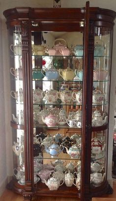 Gorgeous Mahogany Curio Cabinet displays a beautiful collection of fine china Tea Pots. Tea Cup Display, Royal Tea, Teapots And Cups, Antique China, Vintage China, Displaying Collections, Antique Furniture, Tea Time, Tea Party