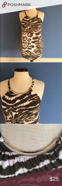 """INC Animal Print Sleeveless Blouse Take a walk on the wild side!  This beautiful animal print blouse will make you """"roar"""".  😃.  Pair with white or Jean capris and heels for a great look.  The front and back are longer in the middle.  Measurements(Flat): Length - 27.5"""" to 29.5""""/Bust - 19.5""""/Waist - 19"""" INC International Concepts Tops"""