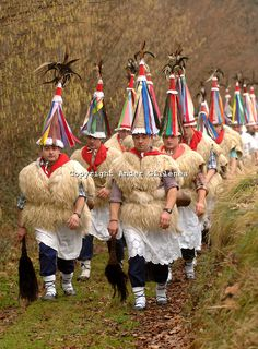 ITUREN, NAVARRE - JANUARY 30: A group of 'Zanpantzar', people dressed in sheep fur and big cowbells tied to their back, march across Ituren village during an ancient traditional carnival on January 30, 2006. Zanpantzar´s march trough Ituren farmhouses and streets sounding their cowbells to wake up the earth for a good new farmer year and keep far away all bad spirits . NAVARRE