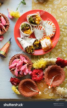 stock-photo-diya-lamps-lit-during-diwali-celebration-with-flowers-and-sweets-in-background-334000979.jpg (996×1600)