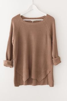 Classic chunky knit sweater Round neckline Long sleeves Side slits Loose fitting 55% Cotton 45% Acrylic Imported