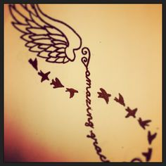 Infinity tattoo w/ angel wings and sparrows then amazing grace written in the middle.