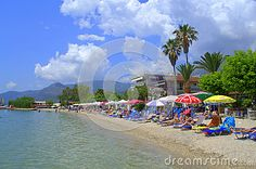 Ionian sea calm water,vacationers relaxing on Nydri  resort beach and Lefkada island  beautiful landscape,Greece