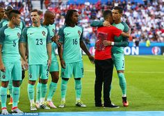Ronaldo embraces the youngster while team-mate Renato Sanches (centre) looks on astonished...