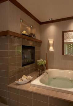 Nothing like putting and electric fireplace in the bathroom next to a jacuzzi tub. Or a T.V.