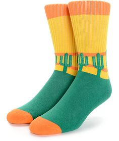 Add a trippy new look to your sock drawer with the Psockadelic Cooler Cactus crew socks. Leave the ordinary behind with the unique orange, yellow, and green color blocked design that features a jacquard knit cactus design and a plush cushioned slight stre