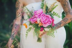 Love this bright pink peony bouquet with touches of gold painted ferns and sprigs of maidens hair. Click to see more Hot Pink and Orange Watercolor Wedding Ideas! {Alexandra Wallace Photography}