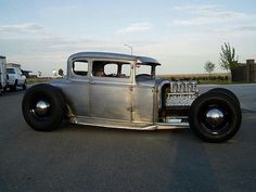 Cool five window coupe with a flathead V8...