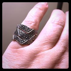 Sterling Silver and marcasite stackable ring set 3 separate rings, meant to be worn together but can be worn individually.  Stackable rings, they fit together like puzzle pieces.  Unusual item!  Each ring is marked 925.  Ring size 6. Jewelry Rings