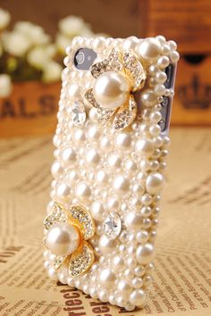 Buy a clear iPhone case and cover it in pearls and beads!