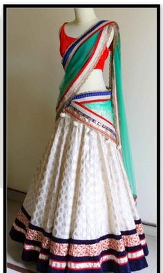 This lehenga saree comes with red color velvet blouse having white color saree skirt in chanderi fabric and green color pallu in net which makes this sarees really inspired. Excellent Mughal collectio