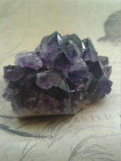 Purple Amethyst Crystal Point Cluster   Size ~ 67mms × 40mms ( Roughly 2.5 inches in length )  Weight ~ 81 grams   All pictures of our Crystals are taken in natural light