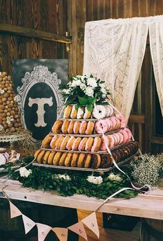 Four-Tiered Donut Tower. A four-tiered donut tower with assorted flavors, created by Caitlan's Catering. Donut Bar, Donut Tower, Doughnut Cake, Donut Wedding Cake, Wedding Donuts, Wedding Desserts, Unique Wedding Cakes, Nontraditional Wedding, Rustic Wedding