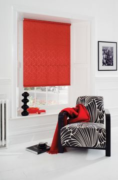 Funky patterned vibrant red roller blind, white room, contemporary black and white chair
