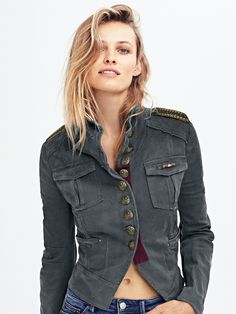 Shrunken Officer Jacket | Tomboy meets femme in this military-inspired jacket with embellished shoulders and a structured shape. Extra details include front pocket details, cropped back, and buttons featuring royal crest detail along the front and on the sleeves. Slightly stretchy fabrication.