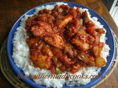 This chicken and tomato dish with all the spices served over rice will quickly become a favorite. Serve it to family and guests for a real comfort food meal anytime.