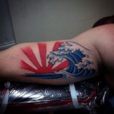 Bicep Male With Japanese Rising Sun Tattoo
