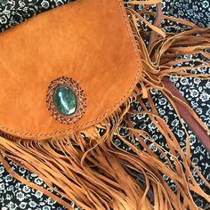Denise Fringe Leather Satchel with Jade Inlay. Available in black, brown and camel. ONLY ONE OF EACH COLOR! Shop @ cuamerchant.com   Cuauhtemallan >> Handmade Heritage™  festival #fashion #etsy #handmade  #bohostyle #bohochic #gypsy #hippie #ootd #style  #vintagestyle #wanderlust #jade #guatemala #purse #handbag #leather #purseaddict #microbusiness #artisan  #festivalfashion #festivalseason #bohovibes #coachella #coachellastyle #socal #fringebag #frin