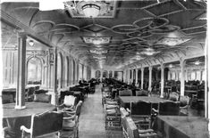 *A 1912 photograph of a dining room on the Titanic. The ship was designed to be the last word in comfort + luxury, w/ an on-board gymnasium, swimming pool, libraries, high-class resturants + opulent cabins.