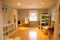 IHeart Organizing: Reader Space: Toy Tastic Multi-Functional Family Space! - Wish my basement were finished, but I love this look and all the functions in this room.