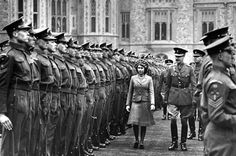 Princess Elizabeth, on her 16th birthday on April 21, 1942, reviews the Grenadier guards, the most senior regiment of British infantry. She was appointed as the Colonel-in-Chief as part of her expanding royal duties.