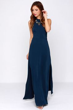 Awe and amazement will overcome anyone who spots you in the Keepsake Adore You Navy Blue Maxi Dress! Medium-weight woven poly creates an elegant foundation for this chic gown, topped with a rounded halter-style neck and darted bodice, for a bit of structure above the maxi-length skirt with twin thigh-high slits. A triangular back cutout rests below a keyhole cutout and button closures for a jaw-dropping statement. Hidden back zipper with clasp. Lined to mid-thigh. Self: 100% Polyester. ...