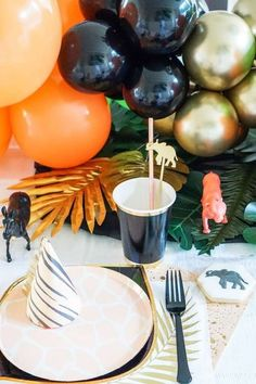 Check out this cool safari party animal birthday party! The table settings are so cool! See more party ideas and share yours at CatchMyParty.com #catchmyparty #partyideas #partyanimal #partyanimalparty #safariparty #tablesettings