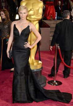 Charlize Theron's black Dior had a bodice that seemed to defy gravity but was held up by transparent straps.