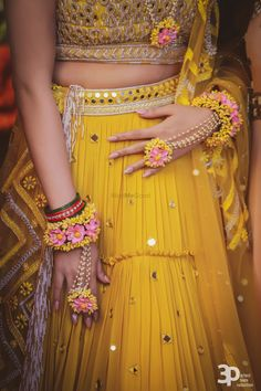 gorgeous yellow mirror work mehendi lehenga with pink yellow floral jewellery. Bridal Mehndi Dresses, Indian Bridal Outfits, Indian Dresses, Indian Bridal Fashion, Pakistani Outfits, Wedding Outfits, Wedding Couples, Wedding Photos, Wedding Dresses