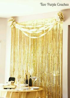 Gold fringe backdrop for a Gatsby themed party