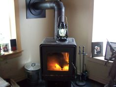 Pictured above is a Stove Lite Pro Thermoelectric Lantern at a house in East Randolph, Vermont. The Stove Lite Pro is a Thermoelectric Lantern that is Powered by a Wood Stove. It has an internal battery, USB charging port & dimming control for off the Stove light adjustment. Thermoelectric Generator, Wood Burning, Vermont, Stove, Lanterns, Usb, Home Appliances, Future, House Appliances