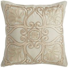 Beading and embroidery form a bold medallion pattern atop a crisp, white cotton cover for a glamorous effect. Plus, it's filled with a soft, shapely poly insert to keep things comfortable. Fabulous.