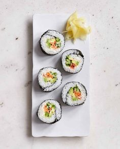 Combine creamy avocado with your favorite crunchy vegetables, like julienned cucumbers and carrots -- in these DIY sushi rolls. Perfect as an appetizer or quick cool lunch outside the office, sushi is a refreshing summer meal that's always delicious. Sushi For Kids, Sushi At Home, Sushi Recipes, Vegan Recipes, Dinner Recipes, Diy Sushi, Sushi Ideas, Sushi Sushi, Homemade Sushi