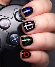 The Nailasaurus: Playstation Nail Art. My boyfriend would love this