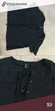 Black crop top black crop top with tie up front, silver hardware, Never worn, I can try and dewrinkle before sending! Forever 21 Tops Crop Tops
