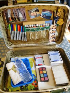 Traveling art studio-- I like these hard cover suit cases :) also perfect for kids all ages to help keep all in one place