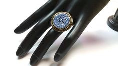 This special ring has a centerpiece made of blue rhinestones and a blue firepolished glass bead. The bronze ring is adjustable and weighs about The size of the centerpiece is about in diameter. Diy Jewelry Rings, Bronze Ring, Glass Beads, Gemstone Rings, Glitter, Etsy Shop, Turquoise, Metal, Blue