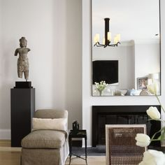 The fireplace is a natural focal point. I did a simple bronze metal surrounding the fireplace and hung a tall rectangular mirror above it, framed in the same bronze. Even though my work cannot be called minimalist by any stretch of the imagination, I will often use a minimalist detail like this.