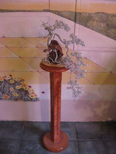 bonsai pendente in alluminio esposto alla mostra