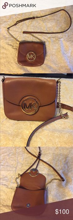 """Michael Kors crossbody bag USED ONCE!! ‼️ in GREAT condition!! ‼️ Michael Kors crossbody bag with gold """"MK"""" on the front. Colors: brown, gold. Has 1 pocket on the inside and 1 pocket on the outside. Bag is closed by a strong magnetic holder. Strap is adjustable so it can be lengthened or shortened to whatever length you want! Great for a night out or a day at the mall! KORS Michael Kors Bags Crossbody Bags"""