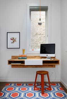 A Mash Studio Wall-Mounted desk offers a place to study. The rug is from One King's Lane and a SoCo Modern Socket pendant illuminates the room.