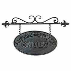 """Metal sign with text detailing.  Product: SignConstruction Material: MetalDimensions: 9"""" H x 15.25"""" W"""
