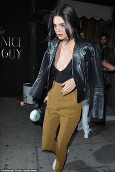 Kendall Jenner shows off her racy side as she flashes her cleavage in plunging top under a biker chick jacket as she enjoys star-studded night in LA | Daily Mail Online