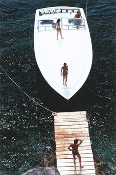 Slim Aarons (1973) Speedboat Landing, Porto Ercole, Italy