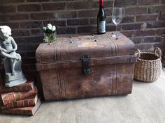 For sale a genuine Victorian trunk/ chest. In a solid condition metal inside and outside. Full of ch