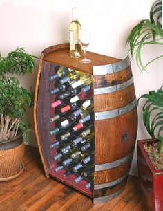 This unique wine barrel wine rack is made from a full 59 gallon Napa Valley oak wine barrel.  This wine cabinet takes up very little room but allows storage for 32 wine bottles.